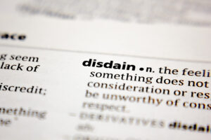 pagea of dictionary explasining meaning of the word disdain