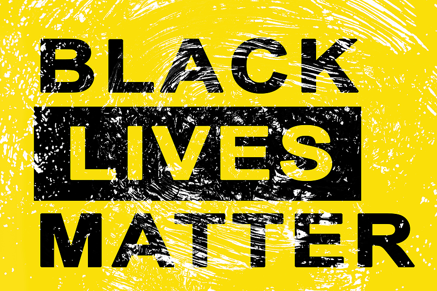 """yellow background with black letters """"Black Lives Matter"""""""