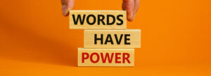 """orange background color with Scrabble tiles spelling out """"Words Have Power"""""""