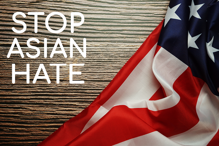 """beige background with part of American flag on right side with words """"Stop Asian Hate"""" on the left side"""